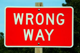 "Road sign reading ""Wrong Way"""